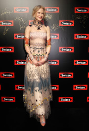 Nicole Kidman exuded whimsical glamour wearing this beaded sheer-overlay gown by Valentino at a Swisse event in Shanghai.