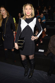 Hofit Golan was equal parts edgy and mod at the Nicole Miller fashion show in a black-and-white sheath styled with a zipper-embellished clutch.