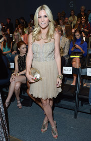 Tinsley Mortimer went for vintage elegance in an Art Deco-inspired cocktail dress when she attended the Nicole Miller fashion show.