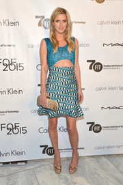 Nicky Hilton opted for snakeskin accessories, including a Bottega Veneta Knot clutch and Christian Louboutin peep-toes.