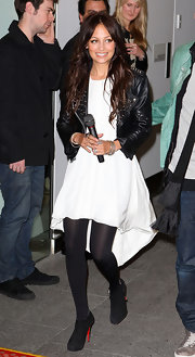 Nicole wore a flowing white dress with black tights and suede platform ankle booties.