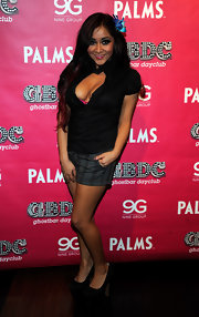 Nicole 'Snookie' Polizzi left little to the imagination in a daring black open front top.