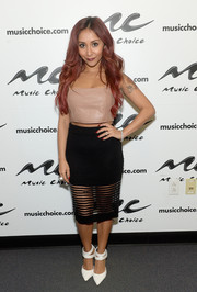 For her footwear, Nicole Polizzi chose a pair of white pumps with strappy ankles.