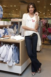Nieves Alvarez presented the new N+V baby collection wearing a pair of mottled snakeskin kitten-heel mules.
