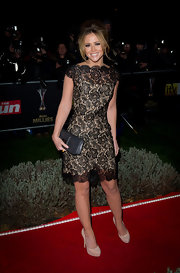 Kimberley Walsh paired a darling lace frock with nude platform pumps.