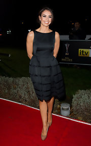 Christine Bleakley looked demure in patent platform pumps. She paired the nude heels with a ladylike navy blue dress.