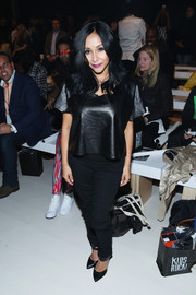Nicole chose a pair of black skinny jeans to team with her leather top.