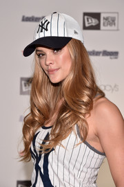 Nina Agdal accessorized with a New York Yankees baseball cap to match her tank top.