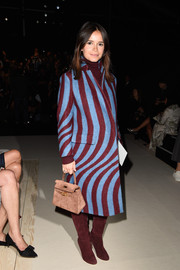 Miroslava Duma cut a striking figure in a two-tone swirl-print coat during the Nina Ricci fashion show.