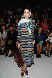 Miroslava Duma went for a chic retro look with this zigzag-print tweed coat during the Nina Ricci fashion show.