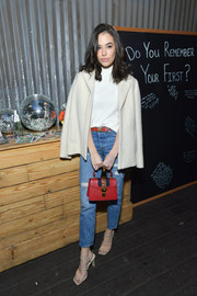 Chloe Bridges teamed ripped blue jeans white a white turtleneck for Nine West's 40th anniversary celebration.