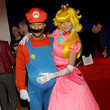Chrissy Teigen and John Legend as Mario and Princess Peach