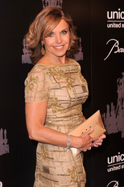 Katie Couric stuck to a neutral palette with this nude envelope clutch and gown combo at the UNICEF Snowflake Ball.