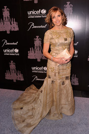 Katie Couric looked downright fab at the UNICEF Snowflake Ball in a nude gown with geometric beading and a voluminous train.