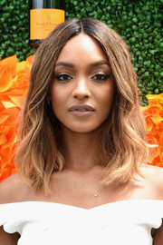 Jourdan Dunn wore her hair down to her shoulders with a center part and subtle waves during the Veuve Clicquot Polo Classic.