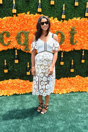 Hannah Bronfman went the ultra-feminine route in a pale-blue and white floral lace cold-shoulder dress for her Veuve Clicquot Polo Classic look.