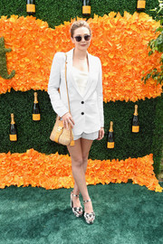 Elizabeth Olsen showed some leg in a white short suit with tonal pinstripes during the Veuve Clicquot Polo Classic.