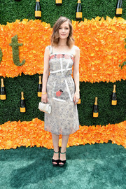 Rose Byrne polished off her look with an elegant silver purse.