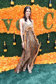 Tao Okamoto swept into the Veuve Clicquot Polo Classic wearing a printed maxi dress with ruffle detailing.