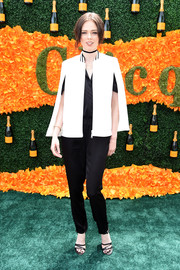 Coco Rocha teamed a white cape with a black jumpsuit for the Veuve Clicquot Polo Classic.
