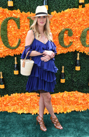 Nicky Hilton amped up the summery feel with a Saint Laurent raffia and leather bucket bag.