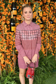 Kaley Cuoco attended the Veuve Clicquot Polo Classic Los Angeles carrying an adorable heart-motif purse by Fendi.