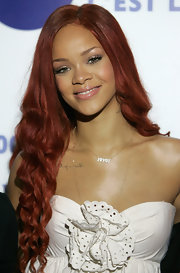 Rihanna dressed up her neckline with an I love You pendant necklace.