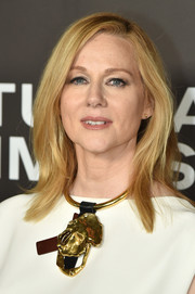 Laura Linney punched up her look with a gold statement necklace.