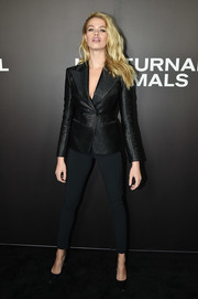Hailey Clauson completed her outfit with black side-striped skinnies.