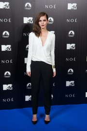 Emma Watson looked flawlessly chic at the 'Noah' Madrid premiere in a black-and-white J. Mendel jumpsuit with a draped bodice and a deep-V neckline.