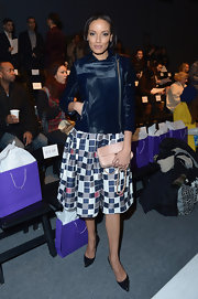 Selita Ebanks looked stylish and polished in a knee-length checkered skirt.