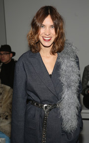 Alexa Chung accessorized with a gray fur scarf for a bit of glamour.