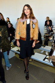 Black triple-strap platforms with bedazzled buckles completed Alexa Chung's look.