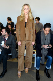 Chloe Lukasiak bundled up in a tan velvet pantsuit for the Noon by Noor fashion show.