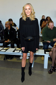Nastia Liukin stayed cozy in a black sweater dress at the Noon by Noor fashion show.