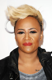 Emeli exhibited her punky style at a fundraising event in London, showcasing her platinum blonde quiff.