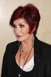 For her hairstyle, Sharon Osbourne went modern with this layered razor cut.