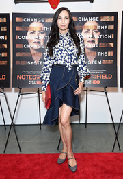 Famke Janssen kept it ladylike in a tie-neck print blouse at the New York screening of 'Notes from the Field.'