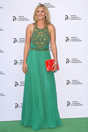 Holly Branson looked simply ethereal in this green flowing gown that featured a golden beaded bodice.