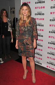 Drew Barrymore showed off her mosaic print dress while attending the Nylon party.