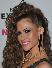 Kimberly Cole showed off striking lighting bolt earrings at the NYLON and Express Denim issue party.