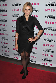 Samaire paired her black tights with a feather embellished wrap dress.