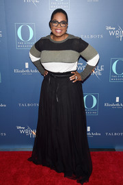 Oprah Winfrey chose a floor-sweeping black skirt to finish off her look.