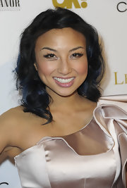 Jeannie Mai finished off her ultra-feminine look with a shoulder-length curly 'do when she attended the OK! Magazine pre-Oscar party.