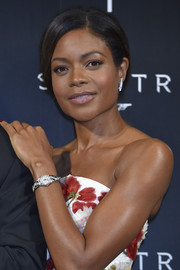 Naomie Harris wore a sleek pulled-back bun to show off her natural makeup at the OMEGA SPECTRE Japan premiere.