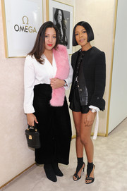 Naomie Harris was all legs in a black short suit by Louis Vuitton at the Omega 'Her Time' pop-up boutique.
