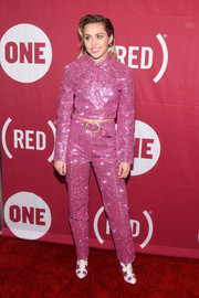 Miley Cyrus looked like rodeo Barbie in a sparkly pink suit by Christian Cowan-Sanluis at the ONE Campaign and (RED) concert to mark World AIDS Day.