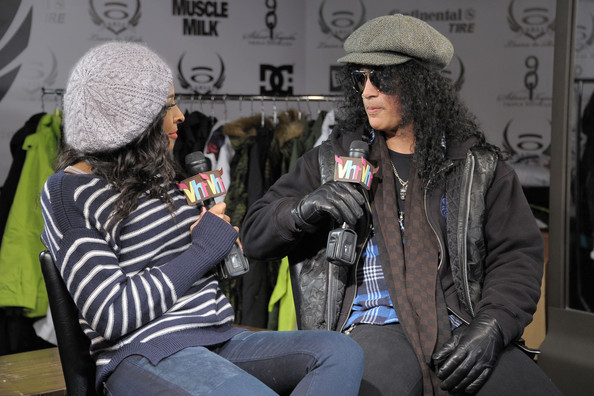 Slash battled the chill with layers of clothing and a pair of black leather gloves.