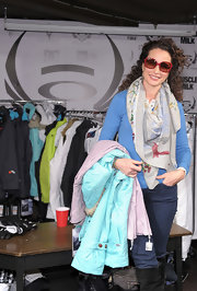 Andie dons a large silk scarf while at an Oakley promotion.