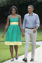 Michelle Obama finished off her colorful look with a pair of blue ballet flats.